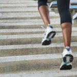 Female athlete running up staircase