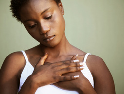 beautiful black woman natural hair hands over heart