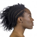 Image of woman with braided hair via Shutterstock