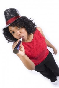 Photo of woman celebrating NYE via Shutterstock